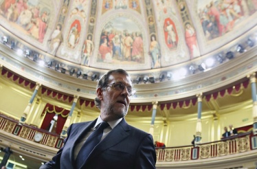 Spain's acting PM Rajoy looks back as he leaves his seat after the investiture debate at the Parliament in Madrid